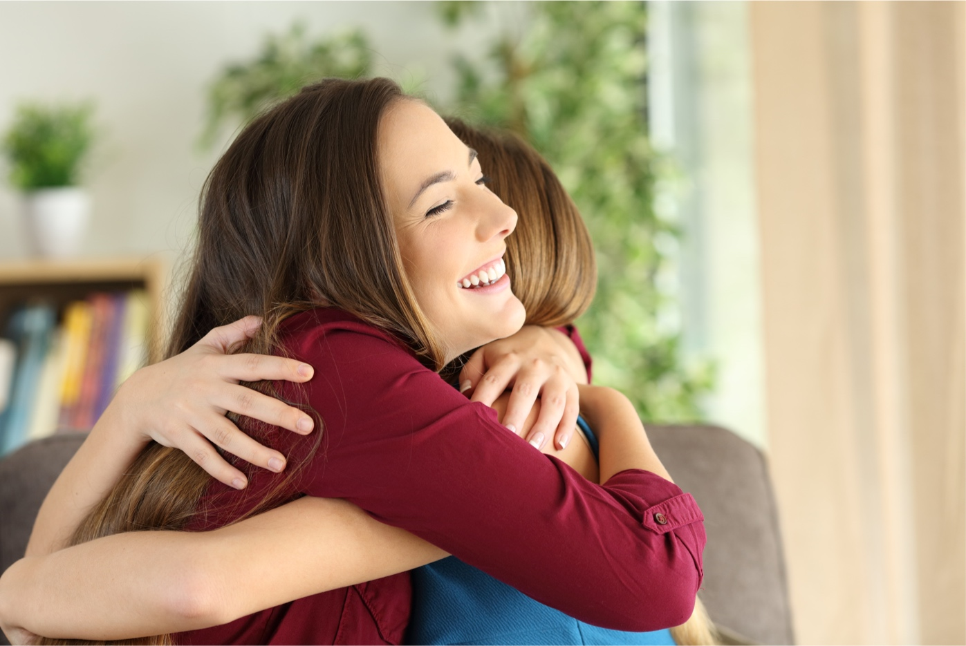 Happy-Woman-Hugging-Family
